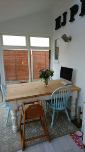 The conservatory has added a beautiful dining space to this home.