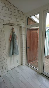 The wood-look uPVC doors and windows are strong and effective.